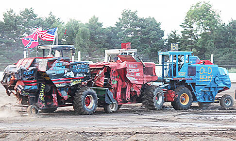 Combine sandwich -- Keith Prothman (#20) is 'sandwiched' in between Payton Beierman (#1) and Alexandria Wegener (A30) in the combine demolition derby on Monday night, July 10, at the Boone County Fair.