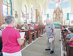 Marion (l.-r.) and Jack Kunzman presented information about St. Michael's Church to a group of 57 visitors who were part of a Moostash Joe tour visiting seven Catholic churches in Northeast Nebraska.