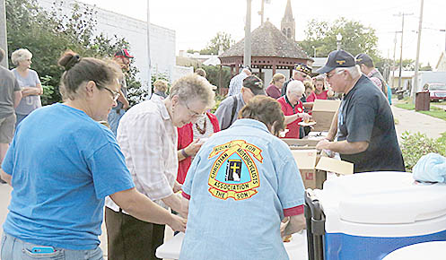 Sons of the American Legion served a Patriot Day meal at the downtown mini-park after Sunday's program.