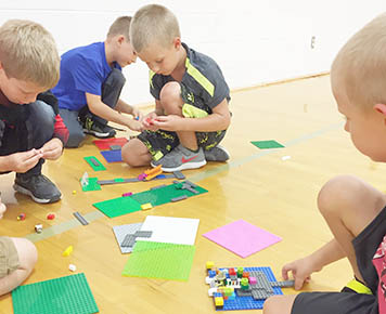 Students build with Legos during 'Cardinal Kids Club' after school.