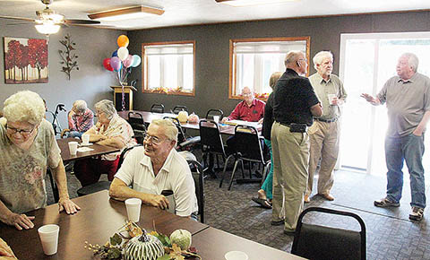 Guests visited and reviewed the Harmony Homes scrapbooks during the Sept. 6 open house.