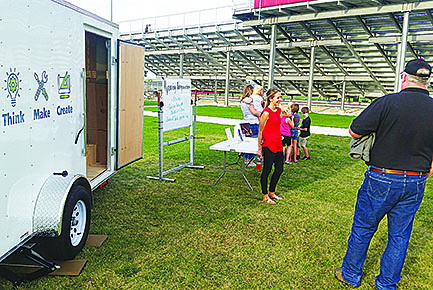 Cardinal Kids Club, the new Boone Central after school program, was displaying its new Maker Space trailer during the kickoff event last Friday, Sept. 22, before the Boone Central football game. Above, Mollie Morrow, program director, visits with Kurt Kruse about some of the upcoming programs.