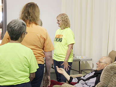 Dawn and Jeff Bussey greet friends during the event last Sunday in the Event Center.
