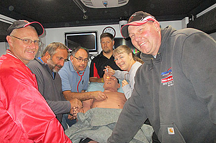 Rescue squad members training on one of the manikins were: (l.-r.)  Neil Baumgartner, Dale Salber, Jim Leifeld, Jared Seier, Kim Fangman and Rod Stuhr.