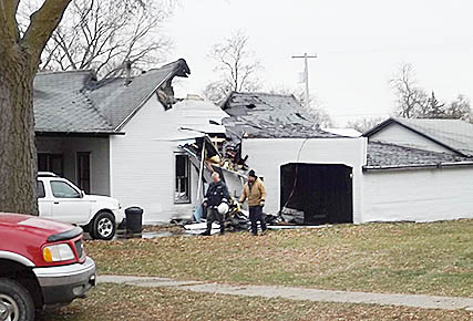 Photo shows a large section of the roof missing from this home that caught fire early Saturday in Cedar Rapids.