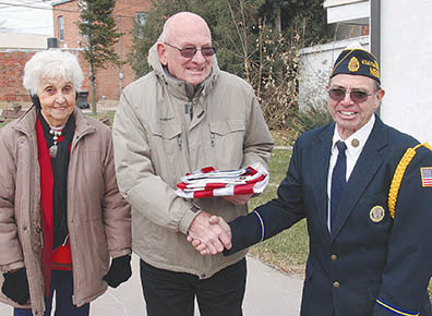 LIVING VETERAN AWARD -- Forrest Francis, center, is congratulated by 2017 Living Auxiliary Member Donna Merten, left, and American Legion Post 162 Commander Leon Magsamen during the  flag-raising ceremony in his honor on Nov. 10.