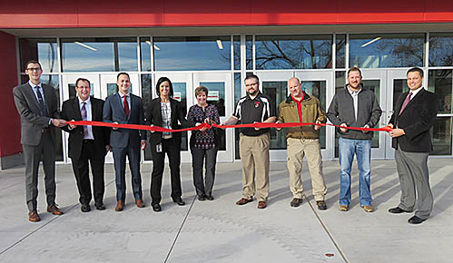 Taking part in a ribbon cutting for the new Boone Central facilities Tuesday were, l.-r., Middle School Principal Tanner Schutt, Education Commissioner Matt Blomstedt, Elementary Principal Jimmy Feeney, Superintendent Nicole Hardwick, Board President Patti Meyer, Board Members Darren Wright, Tim Stopak and Ed Knott, and High School Principal Erik Kravig.