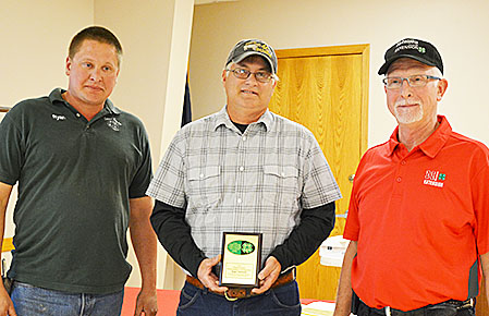 Roger Voichoski (center) was the recipient the 2017 Boone County Heart of 4-H Award during the recent Boone County 4-H Achievement. Presenting the award were 4-H Council President Ryan Neidhardt, l., and Extension Educator Steve Pritchard, r.