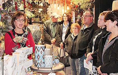 Cindy Stephens, left, talks about her business, St. Edward Floral, during the Community Builders visit.