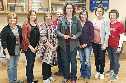 Jill Anding, center, with the first place trophy from Albion Soup Cook-Off.