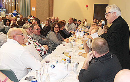 Comedian Willie Farrell, right, entertains some of the Helena employees attending Monday night's event.