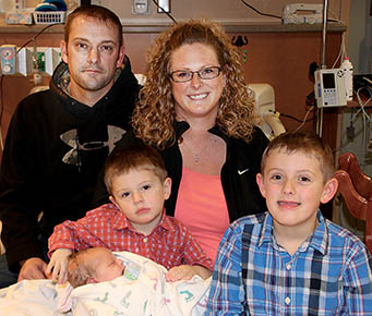 Welcoming the New Year's Baby, Clarence Wayne Shavlik,  at Boone County Health Center Thursday were parents Lee and Kara Shavlik, and brothers Anton (holding Clarence) and Cecil.