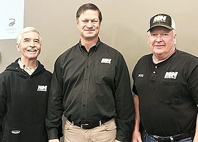 RETIREMENTS PLANNED -- Lonnie Smith (left) pictured here with David Emery, Black Hills Corporation CEO and Pete Sallach (right). Smith and Sallach were congratulated on their retirement during a recent employee meeting in Albion.
