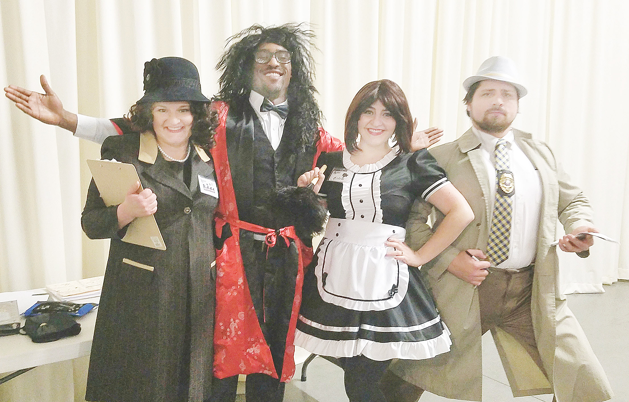 Actors in the murder mystery last Saturday night were, l.-r., Mary Katen Ashley, the production assistant; Sir Warren Peace, Oola La, the French maid, and detective Peter Ness.