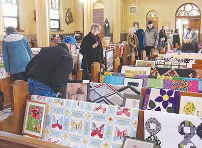 Many area residents arrived early to look over quilts and artwork.